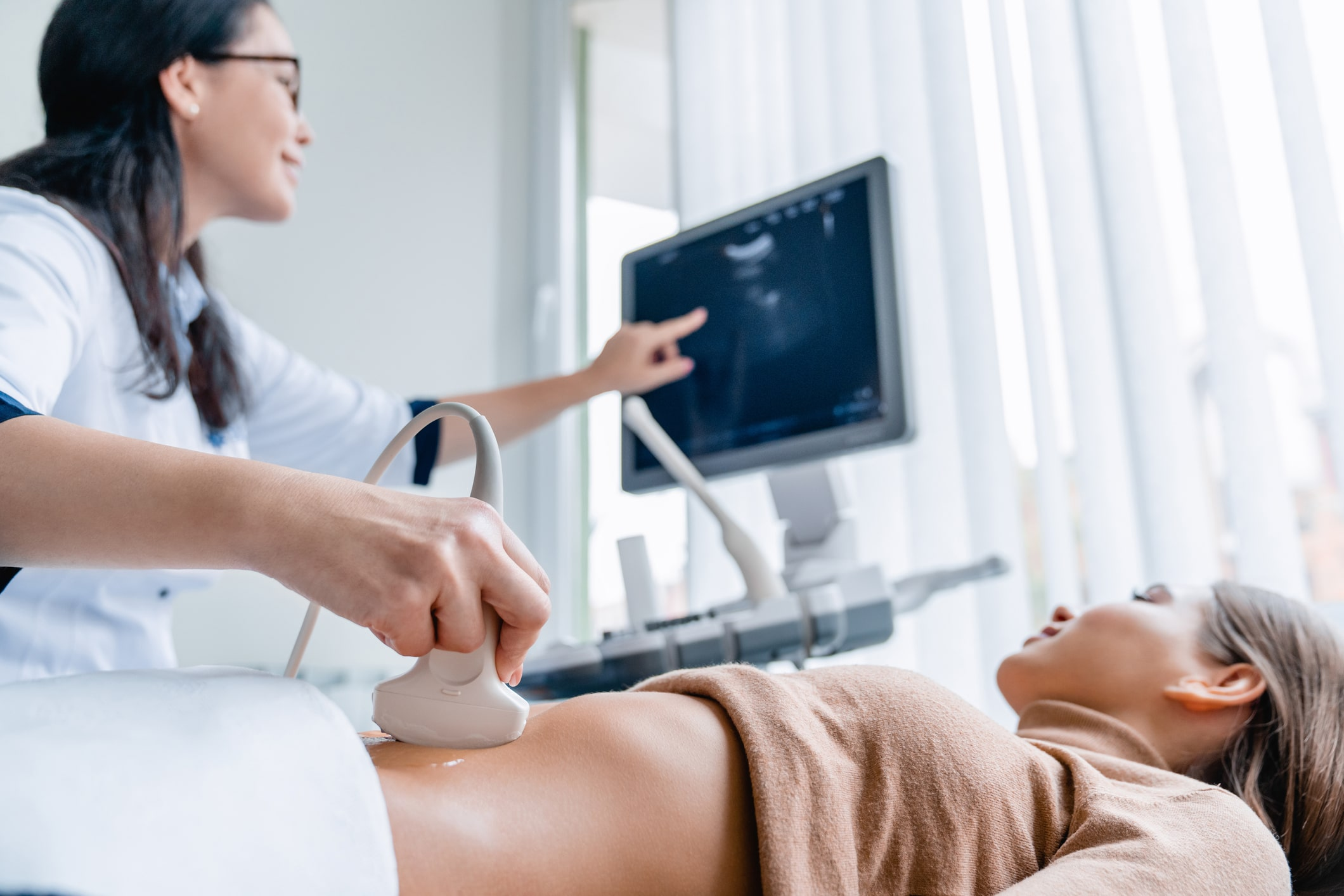 Doctor performing ultrasound